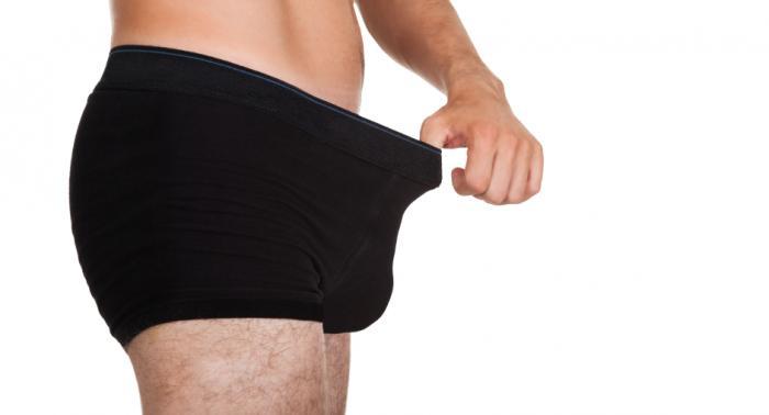 A man looking in his underwear