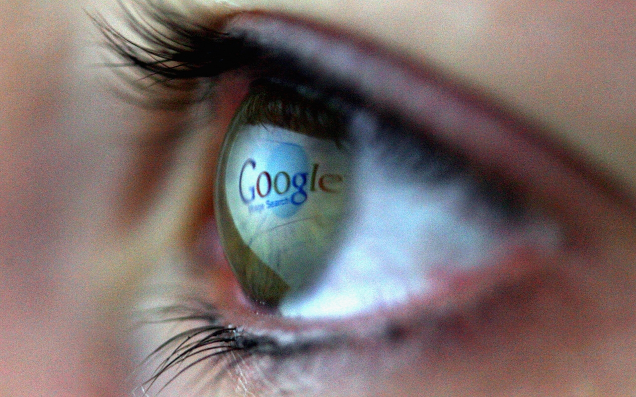 The Google logo reflected in an eye.
