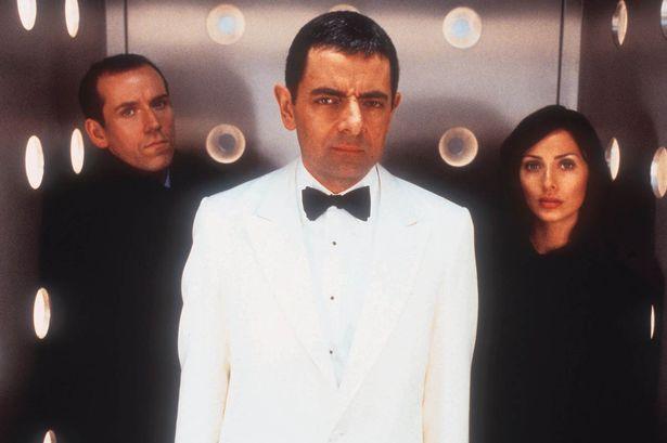 Rowan Atkinson as Johnny English, Lorna Campbell (NATALIE IMBRUGLIA) and Sauvage (JOHN MALKOVICH)