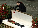 Tomi Rae Hynie, James Brown's wife and a singer in his band, holds a flower over his casket at massive public funeral in Augusta, Georgia.....Picture by: Robin Nelson/Splash News ..Ref: RNAT 301206 M   ....Splash News and Pictures..Los Angeles: 310-821-2666..New York: 212-619-2666..London: 207-107-2666..photodesk@splashnews.com..www.splashnews.com