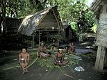 Protective ring: villagers in the remote western highlands of Papua New Guinea say they will not let police talk to the 18 year old rape victim