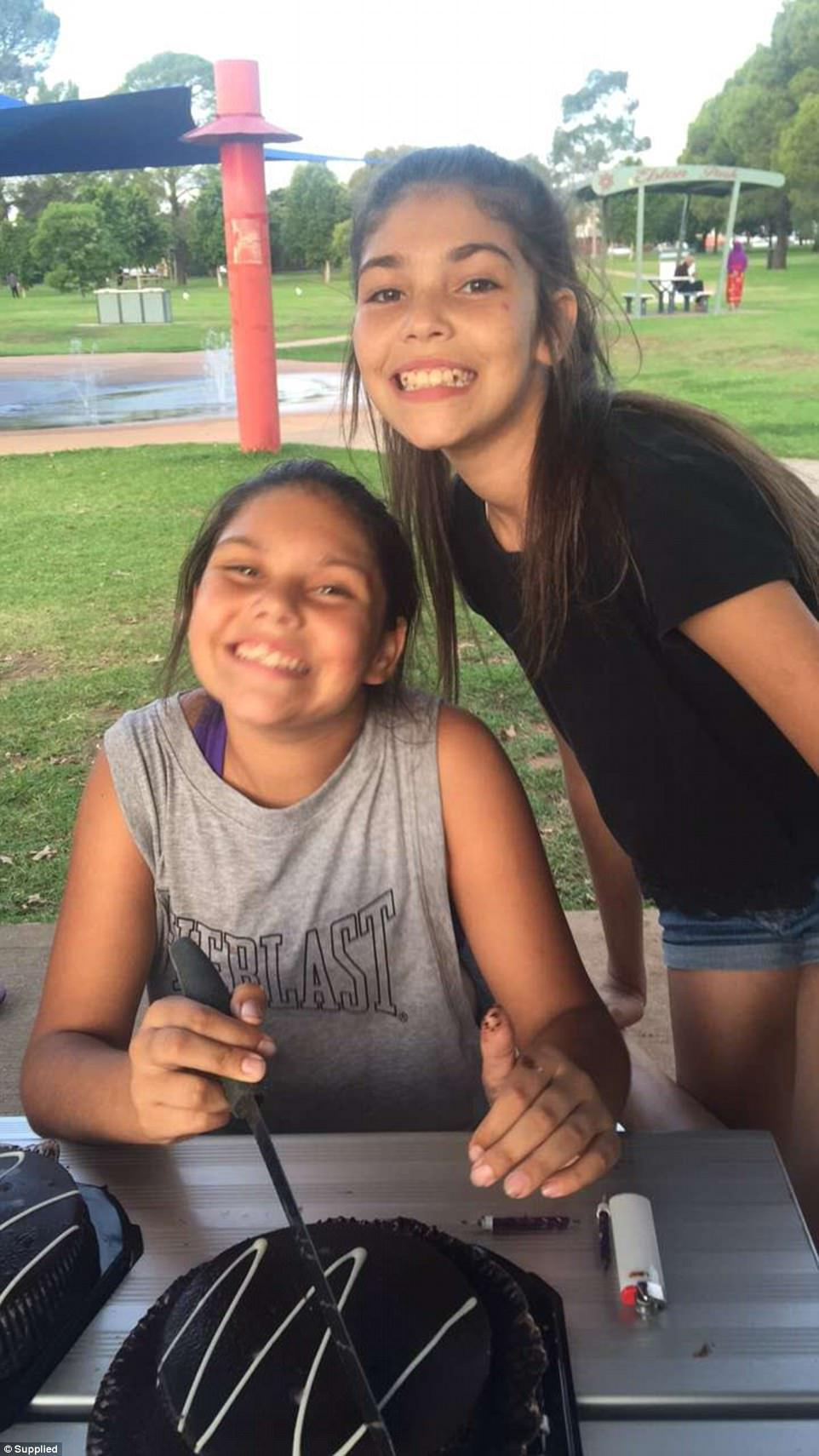 The teenager pictured weeks ago with her sister is excited to be able to 'be happy'
