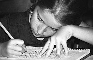 English: A child studying