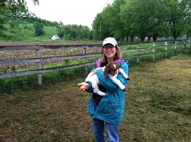 Susan doing chores at the ranch ...